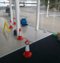 Here we have a a basalt limstone floor in a busy Nation wide HQ, cornered off with red cones and an air mover present to keep the fumes down of a harsh stripper being used. Keeping health and saftey at the top of the list for people passing by