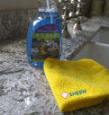 Here is a Granite kitchen worktops cleaning product on a granite countertop with a microfiber cloth